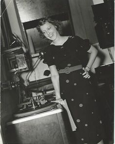 """Original, vintage photo of Jeanette MacDonald by MGM photographer Eric Carpenter for Vick's Open House. Back of the photo states:"""" THE STORY OF A BROADCAST...Jeanette MacDonald whose next MGM picture will be GIRL OF THE GOLDEN WEST in which she will co-star with Nelson Eddy, prepares for her Sunday weekly broadcast.  After the broadcast, Jeanette listens to the """"playback"""" which records the entire program.""""-ESCANO COLLECTION"""