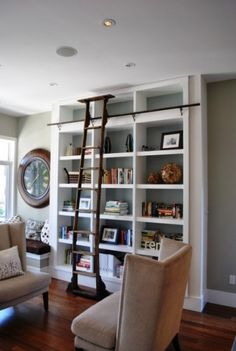 Maybe we could do this in the office or the basement - love the ladder and the wall color behind the shevles