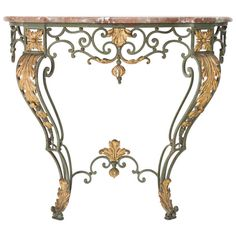 French Wrought Iron Console With Marble Top   From a unique collection of antique and modern console tables at https://www.1stdibs.com/furniture/tables/console-tables/