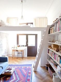 Think I could adapt this into a lovely studio!   Love the lighting and the shelves!