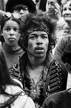 Jimi Hendrix sits in the audience at Monterey Pop Festival in '67.