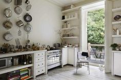 English Kitchen with Pots as Decor Remodelista