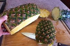 Here's the pineapple with the ends cut off and the slice taken off the bottom.