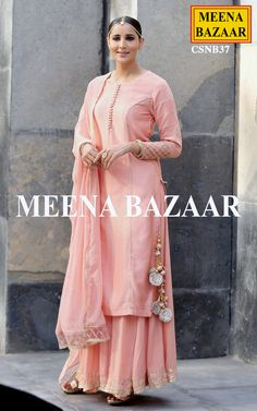 Add Glam to your persona with this amazing Peach Chanderi sharara suit. Embellished with gota work on princess line and fancy buttons on neckline, the kurta features zardosi handwork on cuffs and katha embroidery on slevees. Comes with matching mukesh chiffon dupatta with net detailing on borders and crinkle chiffon sharara.
