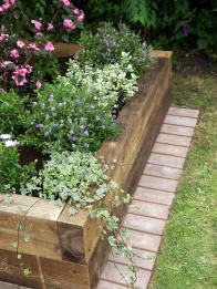 Easy Raised Bed Gardening, nice way to have grass up to garden edge without edging every week.