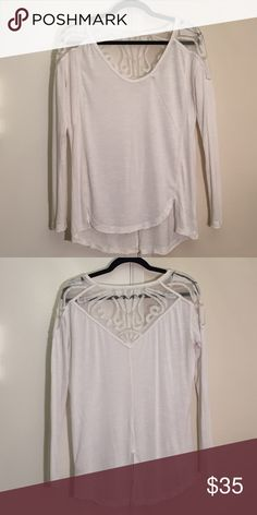 Free People Lace Detail Tee Lace detail shirt from Free People. Tag was cut out because it showed through the lace. Great condition. No trades. Free People Tops Tees - Long Sleeve