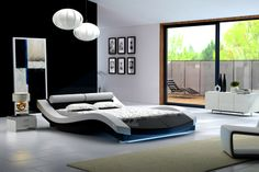 Dit is een kunststof product, met de uitstraling van echt leder en is ijzersterk Bed Calixto - LED heeft een modern design in witte kleur met zwarte accenten. Het hoofdbord beschikt over 2 dikke rolkussens als hoofdsteunen. Zeer comfortabel tijdens het televisie kijken. De zijkanten zijn golvend wat zorgt voor een luxe uitstraling. Onder het voetenbord zit een LED-strip met keuze uit blauwe of paarse verlichting. http://www.meubella.nl/slaapkamer/bedden/3168-bed-calixto-led.html