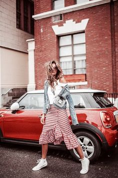 Checked red and white midi skirt, white tee and light blue denim jacket outfit