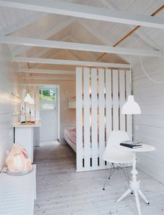 Good room divider to both separate and yet allow for a feeling of uninterrupted space. This would work for a small cabin all on one floor. The kitchen could even be placed opposite this bed area.