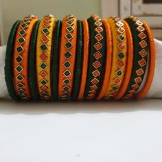 Check out these silk thread bangles design like multicolored bangles, handmade bangles, kundan bangles, etc and find the most stylish silk thread bangles for bride. Silk Thread Earrings Designs, Silk Thread Bangles Design, Silk Bangles, Gold Bangles Design, Bridal Bangles, Thread Jewellery, Fabric Jewelry, Beaded Jewelry, Handmade Jewelry