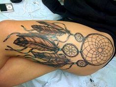 LOVE. I want a dream catcher tattoo...probably not this big though and probably not on my thigh either.