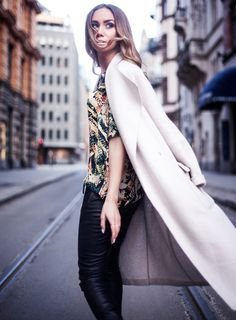 printed top with coat and leather trousers