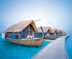 Maldives...one day...Cocoa Island's 23-room hotel that features suites resembling local dhoni fishing boats that are anchored to the ocean floor with pine poles. Best feature? Steps in the back of each suite/boat lead right into the water.