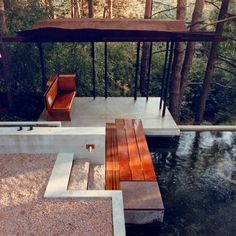 Shim-Sutcliffe built the platform from concrete and added a wooden bridge across the water to the pavilion, which is made from Corten steel supported by slim steel columns.