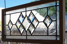 leaded glass window - hang from the ceiling to help divide a space.