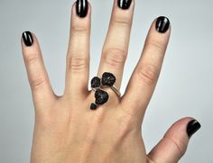 Silver and black pumic ring. Made to resemble bone marrow.