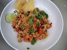 Southwestern Pasta Toss Recipe - This fast and flavorful toss together pasta dish is hot, hearty, and served up in 30 minutes. This is a simple dinner with the warmth of cumin, spicy heat of the jalapeño and cooled off by the refreshing lime and cilantro. (Affiliate)