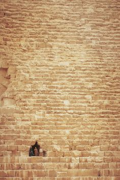 Peeking out from a pyramid. Cairo, Egypt. Shows just how massive these structures really are!