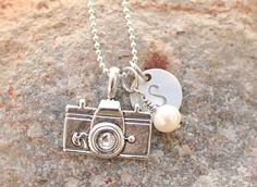 Camera necklace hand stamped with pearl and small stamped initial charm. $16.00, via Etsy. - Must have with JDP on it!