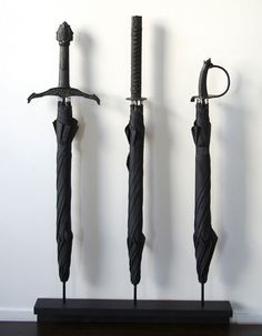 If it rains the day the zombie apocalypses starts, I'll be ready.     Umbrellas designed by Bruce and Stephanie Tharp.