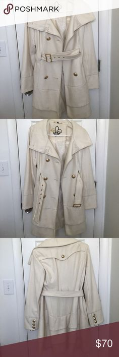 White Guess Coat Very warm. Fun to wear over cocktail dresses in the winter. There's a small black mark that I believe is make-up and is pictured. Guess Jackets & Coats Trench Coats
