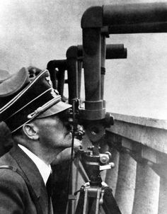 Hitler watches a battle being waged outside Warsaw in 1939.