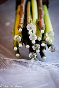 Sometimes the detail is in the small things. Capped flower stems with pearls and diamond.