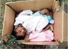 Photo: Baby found abandoned in carton near a refuse dump in Akwa Ibom cries to death