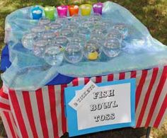 Players are given 3 balls to try their chance at getting a ball into a fish bowl with a squirt fish in the bottom. If they get their ball into an empty fish bowl, they receive a consolation prize. Cheap Carnival Games, Kids Carnival, Carnival Themed Party, Spring Carnival, School Carnival, Carnival Birthday Parties, Circus Birthday, Circus Party, Carnival Ideas
