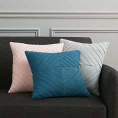 """<span class=""""copyHeader"""">nip tuck.</span> Diagonal pleats angle a tailored diamond pattern on this linen-like pillow. Perfect for layering or as a singular statement. Pleated grey front flips to solid same-color back. Do the math: CB2 low prices include a pillow insert in your choice of plush feather or lofty down-alternative (a rare thing indeed).<br /><br /><NEWTAG/><ul><li>100% cotton</li><li>Front: Cotton pleat design</li><li>Back: Solid grey</li><li>Down-alternative insert: 100%…"""