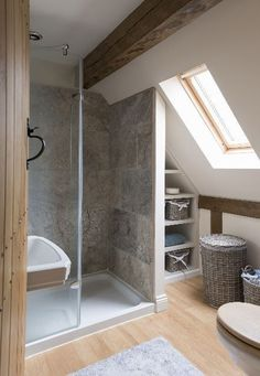 This may be a tiny bathroom but look how well the space is utilised, plus the roof window allows the light to just flood in and give more of an impact.