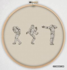 Thats no moon... Its a Moonwalker.  This cross stitch pattern features three Star Wars Stormtroopers rockin some Michael Jackson dancing moves.