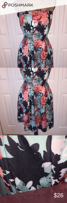 Floral Dress GUC. A little piling as seen in the third photo. Very stretchy and has pockets! New York & Company Dresses Midi