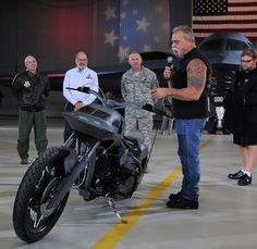 """WHITEMAN AIR FORCE BASE, Mo. - Paul Teutle Sr., Orange County Choppers, explains the different concepts of the B-2 Stealth Bike, 'The Spirit of Innovation,' to members of Team Whiteman Dec. 4. As ensign of Northrop Grumman's B-2 20th anniversary celebration, the B-2 Stealth Bike will appear at Northrop-sponsored events throughout 2009.  Custom bike builders Orange County Choppers of Newburgh N.Y. will showcase it on this year's season premiere of """"American Chopper"""" on TLC. (U.S. Air Force…"""