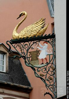 Stock Photo: Alsace wine route Colmar France local product market shop sign with swan. Swans, Colmar France, Storefront Signs, French Signs, Pub Signs, French Countryside, Business Signs, Store Signs, Advertising Signs
