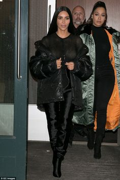 Lookalikes: Kim was accompanied by a femail pal who also wore a puffy coat over an all-black ensemble