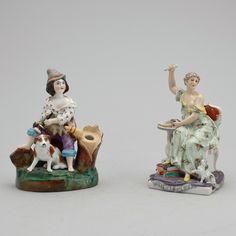 FIGURINER 2 st, porslin, möjligen Tyskland, 1900-tal.  Bemålad porslin föreställande kvinna med böcker samt pojke med hund. Höjd ca 15-15,5 cm.
