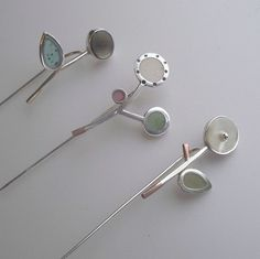 Fiona Chapman Jewellery Three Flower Pins Silver pins with multi media detail (mother of pearl, coloured glass, copper, gold foil)