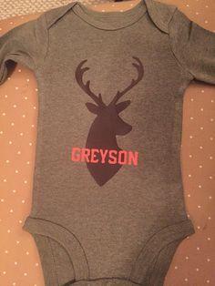 Personalized baby onesie with deer head and name using Siser heat transfer vinyl.