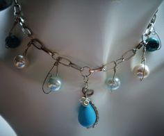 #turquoisependant #pendantnecklace #pearlglassbeads #metalnecklace #chainnecklace #bibnecklace #wrappedpendant #wrappednecklace #wirenecklace #wirependant #teardropsemipreciousbead #silverchainnecklace