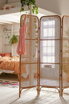 Rattan Screen Room Divider ideal for studio apartment because they also let through light