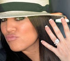 Khloe Kardashain - Her ring is fantabulous! and her manicure is nice too!