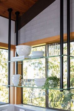 Suspended glass shelves in contemporary style kitchen
