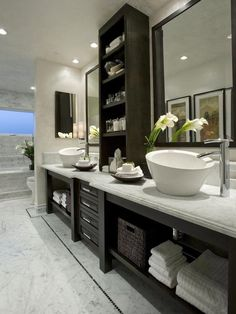 Stone counter against the dark timber - very classy. Shelves add a spa like feature