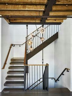 Contemporary staircase in stairwell with exposed reclaimed beams and modern chandelier - 10 Hubert Street New York. Conservation project, restoring a dilapidated building in the TriBeCa area creating a beautiful three storey penthouse. Industrial Stairs, Industrial House, Modern Industrial, Rustic Modern, Duplex New York, New York Penthouse, Penthouse Apartment, York Apartment, Architecture Restaurant