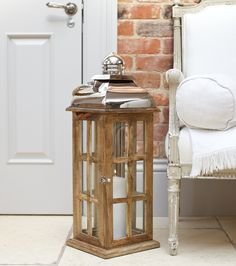 Our mango wood 'Ottery' lantern has a stylish phone box style. Can be used outdoors as made with high quality stainless steel and mango wood.