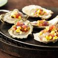 Grilled East Coast Oysters with Corn Jalapeno Slasita  By: Rafael Palomino  Latin Grill: Sultry and Simple Food for Red-Hot Dinners and Parties Cookbook  From: epicurious.com  Just the name of that cookbook makes me want to try this right away and then go buy the cookbook!