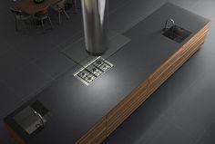 Cocina. Pavimento porcelánico de gran formato. Bancada de cocina realizada en porcelánico de gran formato (150 x 300 cm.). Imagen 3D fotorrealista. actua.es