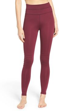 An extra-high waist and seamed knees create a flattering fit in stretchy workout leggings.
