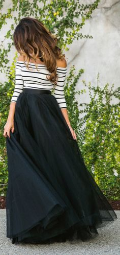 Last Year's tulle skirt trend: Kim Le is wearing a black maxi tulle skirt from Space 46